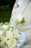 Groom's buttonhole and bouquet Stock Photos