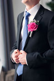 Groom's buttonhole in the form of a rose Stock Photos