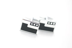 Groom`s cuff links on isolated background Stock Image