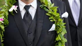 Groom's flowers - hawaiian wedding. A groom's boutonniere and male lei for his hawaiian wedding Stock Photography