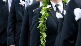 Groom's flowers - hawaiian wedding. A groom's boutonniere and male lei for his hawaiian wedding Royalty Free Stock Image