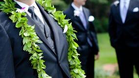 Groom's flowers - hawaiian wedding. A groom's boutonniere and male lei for his hawaiian wedding Stock Photos
