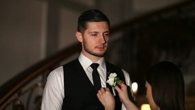 A groom`s friend wears a boutonniere stock video footage