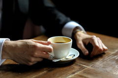 Groom's hands holding cup of coffe. E close-up Royalty Free Stock Photography