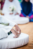 Groom's hands on lap Royalty Free Stock Images