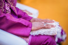 Groom's hands on lap Royalty Free Stock Image
