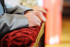 Groom's hands on the pillow Royalty Free Stock Photo