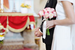 Groom's hands on wedding ceremony Stock Images