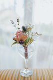 Groom`s orange blossom with rose and wild flowers waiting for gr. Oom in a glass of water royalty free stock images