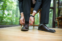 The groom's shoes. The groom bent over to tie his shoe Stock Images