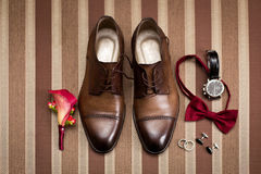 Groom`s shoes and wedding flowers Stock Image