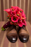 Groom`s shoes and wedding flowers Stock Photo