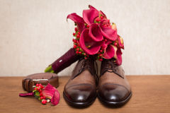 Groom`s shoes and wedding flowers Stock Images