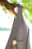 Groom's Wedding Jacket Hanging on a Tree Branch Royalty Free Stock Images