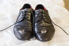 Groom`s wedding shoes and wedding ring royalty free stock photos