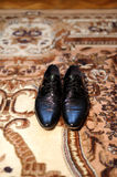 Groom's Wedding Shoes. On carpet Royalty Free Stock Photography