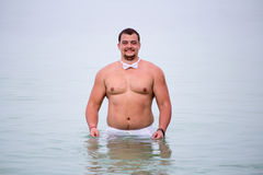 Groom in the sea Stock Photography