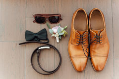 Groom set clothes. Wedding rings, shoes, bow tie Stock Photos