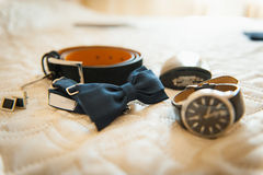 Groom set clothes. Wedding rings, shoes, cufflinks and bow tie Royalty Free Stock Photo
