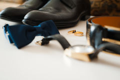 Groom set clothes. Wedding rings, shoes, cufflinks and bow tie Royalty Free Stock Images