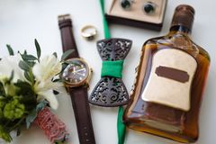 Groom set. The groom`s set watch, ring, butterfly, cufflinks and alcohol stock photography