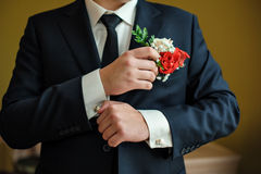 Groom in a shirt and tie in the morning wears cufflinks Royalty Free Stock Photo