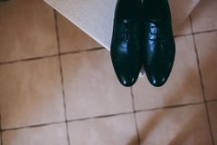 Groom shoes close-up at wedding royalty free stock photo