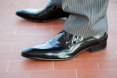 Groom shoes royalty free stock photography