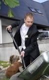 Groom with shovel Royalty Free Stock Photo