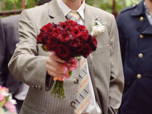 Groom Showing Bouquet Royalty Free Stock Photo