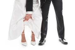 Groom is showing bride's feet, shoe, dress - wedding, marriage. Royalty Free Stock Photo