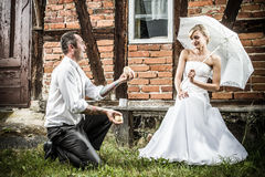 The groom shows off in front of the bride royalty free stock image