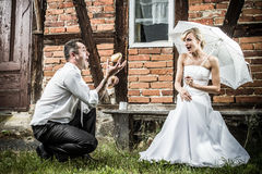 The groom shows off in front of a bride Stock Photography
