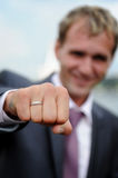 Groom shows a ring Royalty Free Stock Photos