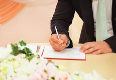 Groom sign wedding contract Stock Photography