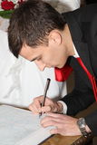 Groom is signed Stock Photo