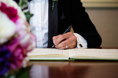 Groom Signing Stock Photography