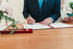 Groom signing marriage license Royalty Free Stock Images