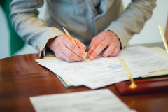 Groom signing marriage license Royalty Free Stock Photos