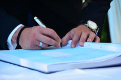Groom  signing the marriage register book Royalty Free Stock Image