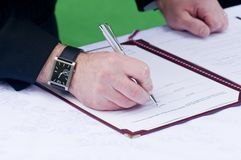 Groom Signing Wedding Register Royalty Free Stock Photography