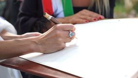 Groom signing the wedding register. Royalty Free Stock Photo