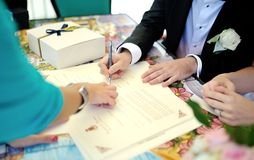Groom signs documents Royalty Free Stock Photo