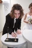 Groom is singing a document Royalty Free Stock Photo