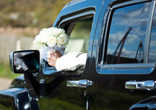 Groom is sitting in the car Stock Images