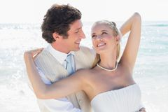 Groom smiling at and embracing his bride Royalty Free Stock Images