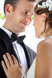 Groom smiling and staring into his bride Royalty Free Stock Images
