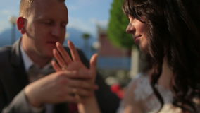 Groom softly touches bride's hand close up. Lake Como, Italy on background stock video footage
