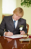 Groom solemnly signed documents. The groom solemnly signed wedding documents Royalty Free Stock Photo