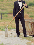 Groom with Spade Royalty Free Stock Image